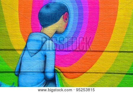 Street art Montreal boy looking in hole