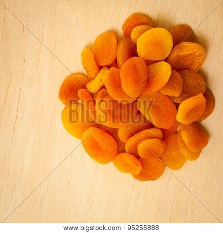 Healthy Diet. Dried Apricots Set On Wooden Table.