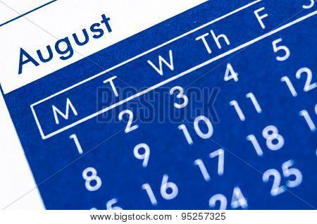 Close Up Of Spiral Bound Calendar Displaying Month Of August.