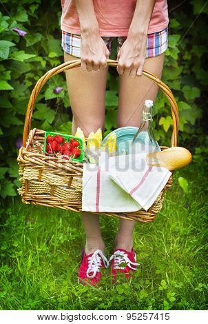 Young Girl Holding A Picnic Basket With Berries, Lemonade And Bread.
