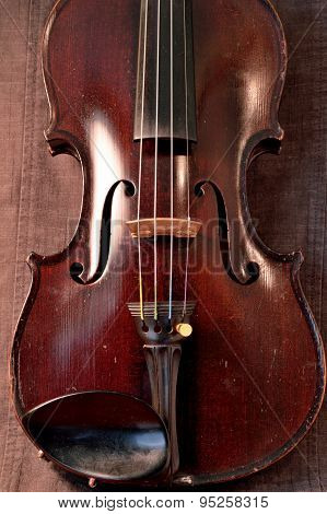Antique Violin Against Gray Background