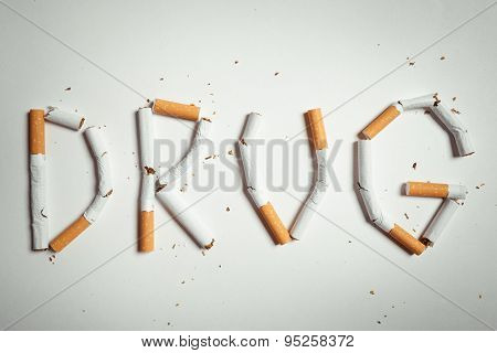 word DRUG, made of cigarettes