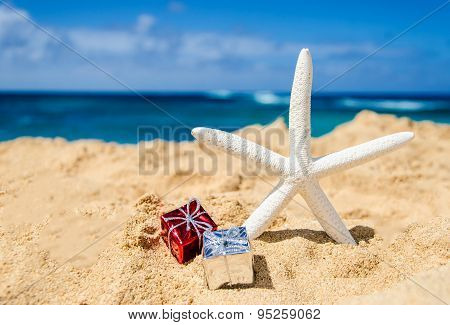 Starfish With Gift Boxes On The Sandy Beach