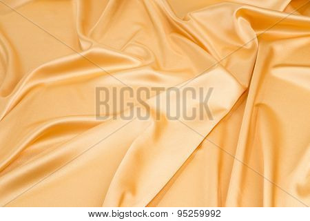 Golden silk drapery.