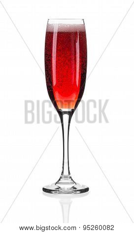 Close up of red champagne glass.