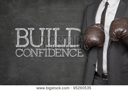 Build confidence on blackboard with businessman