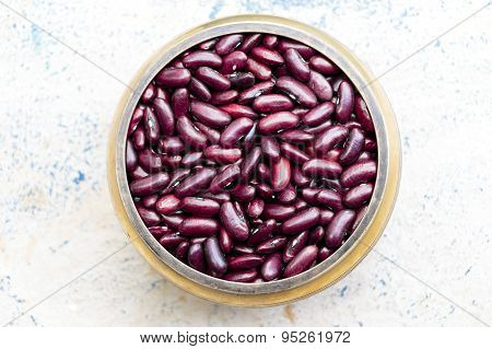 Kidney beans kept on a brass bowl on a plain background