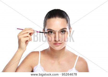 Beautiful Woman Applying Some Mascara