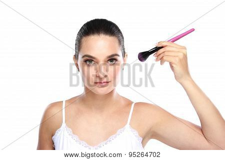 Beautiful Caucasian Model Holding Kabuki Brush