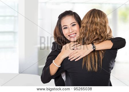 Two Young Businesswoman Have A Reconciliation, Isolated