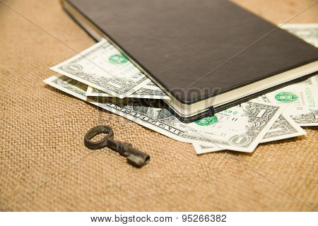 Notebook, Key And Money On The Old Tissue