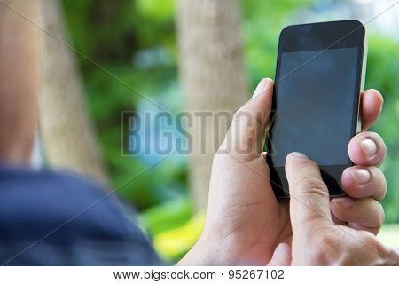 older man checking his phone background