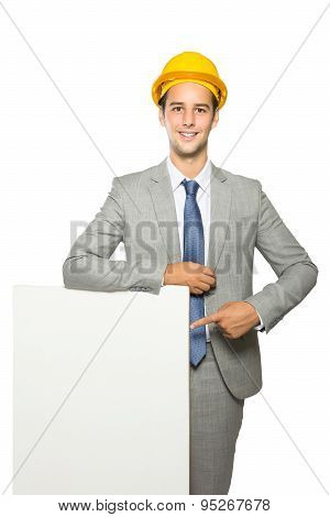 Young Contractor Pointing At Whiteboard