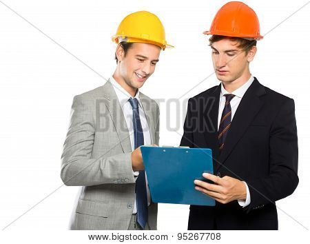 Two Contractors Discussing About Their Project