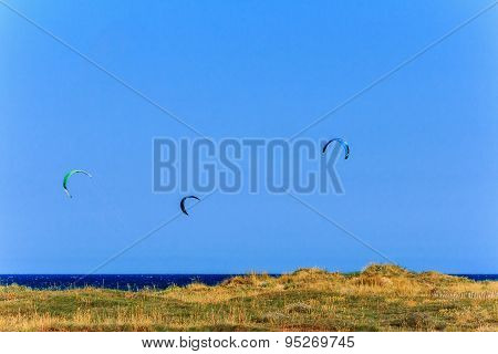 Mediterranean seascape with kite flying
