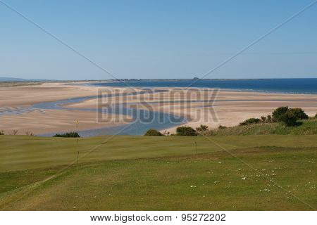 Bamburgh golf course overlooking Budle Bay and Holy Island
