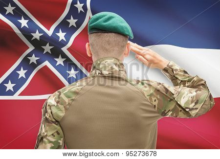 Soldier Saluting To Usa State Flag Conceptual Series - Mississippi