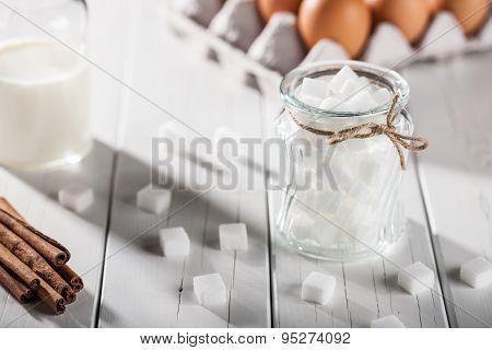 Eggs, Milk, Cinnamon, White Sugar On Wooden Table