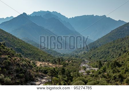 Fango Valley In Corsica With Mountains In Background