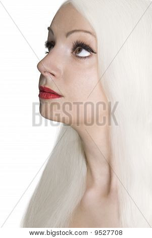 Portrait Of Blond Beautiful Woman With Long Hair.