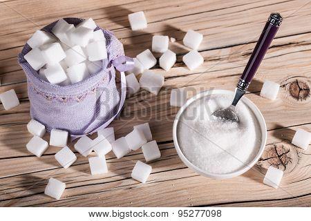 White cubes sugar and granulated sugar closeup