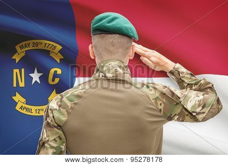 Soldier Saluting To Usa State Flag Conceptual Series - North Carolina