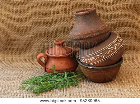 Still Life With Pottery And Dill On A Background Of Burlap.