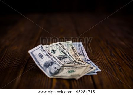 dollars on the wooden floor