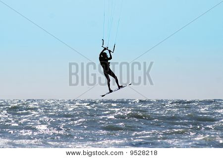 Silhouette Of Kite Surfer In A Sea