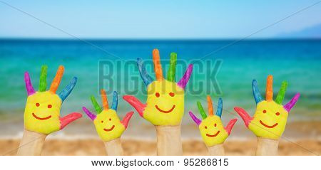 Children Smiley Hands On A Beach