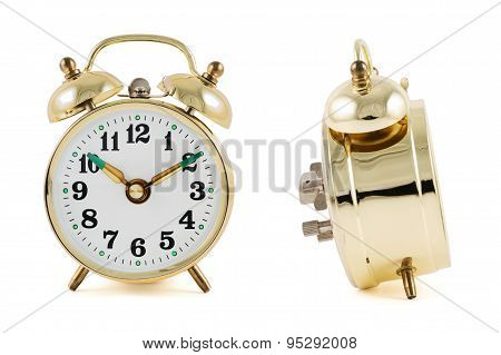 Golden mechanical alarm clock isolated