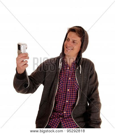 Man In Hoody Taking Selfie.