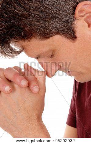 Close Up Of Praying Young Man.