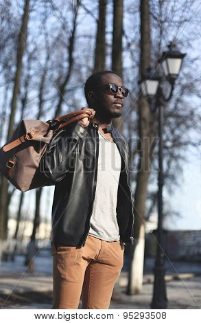 Fashion Elegant Young African Man Wearing A Black Leather Jacket With Bag In The City