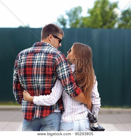Portrait Of Beautiful Young Couple Together In The City, Wearing A Casual Shirts And Sunglasses, Rea