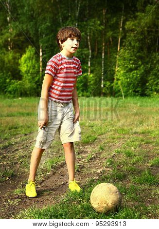 preteen handsome boy play soccer