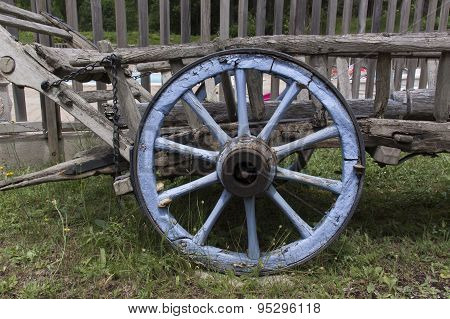 Blue Wooden Wheel At An Vintage Wagon