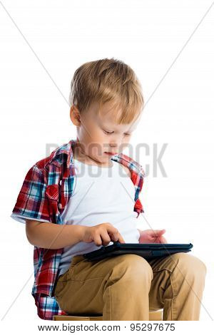 Boy In A Plaid Shirt With A Tablet Computer