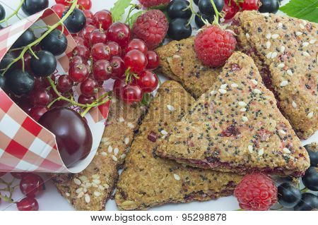 Integral Biscuits With Bunch Of  Fresh Currant Cherries And Raspberries