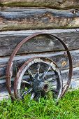 picture of wagon wheel  - Old wooden wagon wheel in yhe countryside - JPG