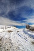 pic of slippery-roads  - slippery road with snow and turn right - JPG