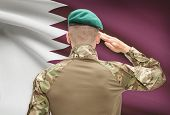 stock photo of qatar  - Soldier in hat facing national flag series  - JPG