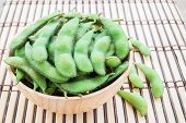 foto of soybeans  - Fresh green soybeans in wooden bowl on wooden background - JPG