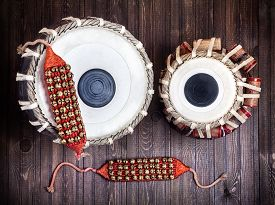 foto of bharatanatyam  - Tabla drums and bells for Indian dancing on wooden background - JPG