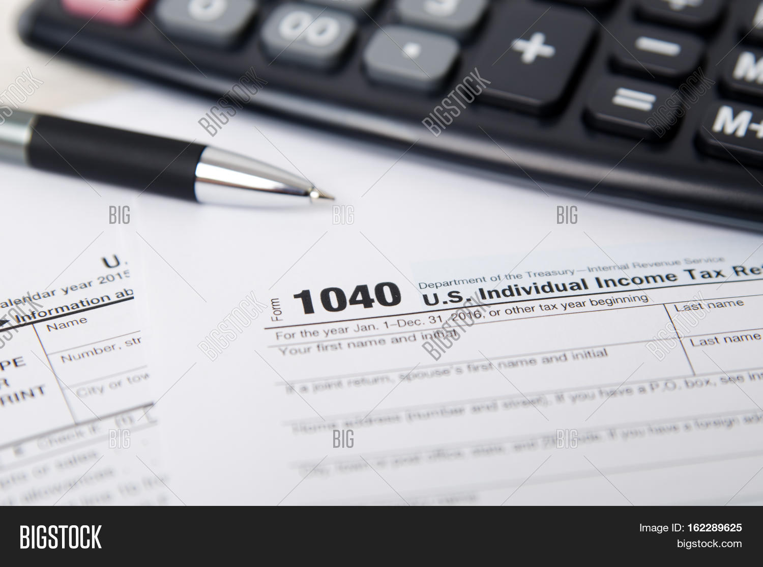 Us tax form 1040 pen calculator image photo bigstock for 1040 tax table calculator
