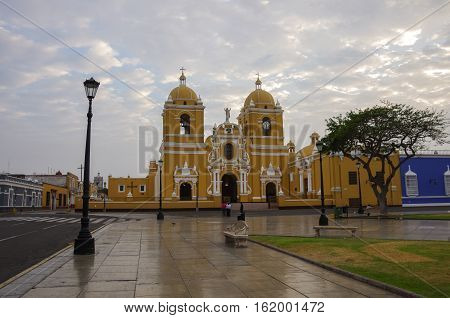Bright Yellow Colonial Style Cathedral In The Plaza De Armas Of Trujillo In Early Morning, Peru