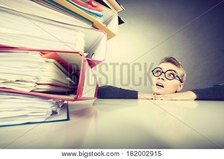 Accountant Terrified Of Pils Of Binders.