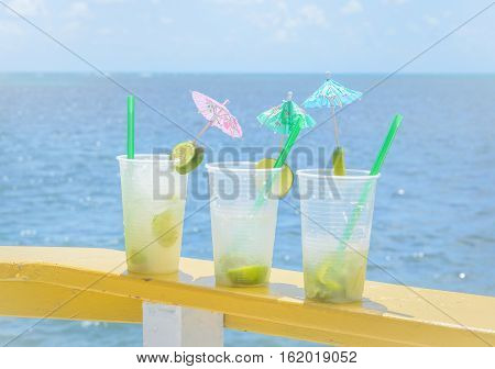 Caipirinha Drink In Boat Support With A Blue Sea Background On A Beautiful Sunny Day.