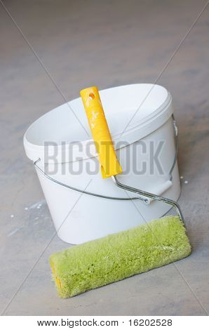 Home Improvement Paint Roller And Paint Tin