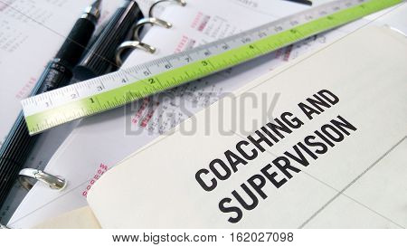 Coaching and supervision on book and ruler